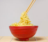 Noodles and chopsticks Royalty Free Stock Photo