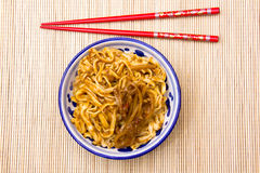 Noodles and chopsticks Stock Images