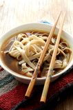 Noodles with chopsticks shot closeup Royalty Free Stock Images