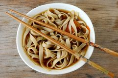Noodles with chopsticks shot closeup Royalty Free Stock Image