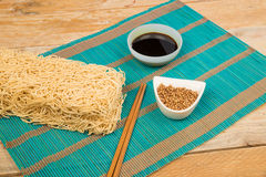 Noodles and condiments Stock Photography