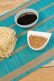 Noodles and condiments Stock Images
