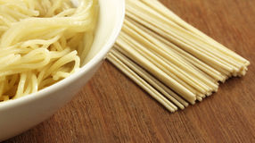 Noodles- cooked and uncooked Royalty Free Stock Image