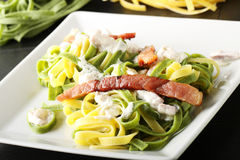 Noodles with cream and bacon. On complex background Stock Photography