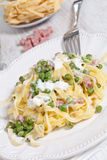 Noodles with cream and ham Stock Images