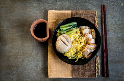 Noodles with crispy porks and giant meat ball Royalty Free Stock Image