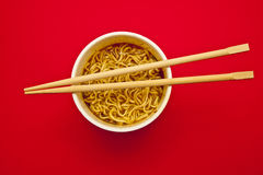 Noodles Cup and chopsticks Royalty Free Stock Photos