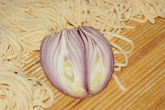 Noodles and cut onions Stock Image