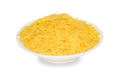 Noodles. Egg noodles in a bowl closeup isolated on white background Stock Image