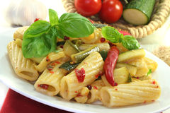Noodles with fiery chili and zucchini Royalty Free Stock Images