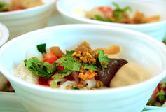 Noodles with fish ball in red sauce. (Yong Tau foo Royalty Free Stock Photo