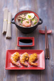 Noodles with fried shrimps. Traditional Oriental seafood, noodles with fried shrimp on a table Stock Photos