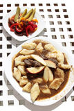 Noodles and game meat stew with lot of sauce on white plate Stock Images