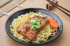 Noodles with grilled teriyaki chicken on plate Stock Images