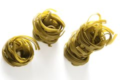 Noodles. Isolated spinach green noodles on white background royalty free stock photography
