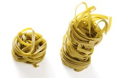 Noodles. Isolated spinach green noodles on white background stock photo