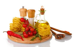Noodles, jar of oil, spices Royalty Free Stock Photos