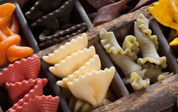 Noodles in a letter-box. Different colored Pasta in an old letter-box Stock Images
