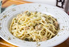 Free Noodles Made With Capers, Onion, Cheese And Tuna In Olive Oil, Seasoned With White Wine And Served In A Deep Dish Decorated With Royalty Free Stock Image - 160502166