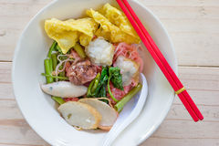 Noodles with meat ball and red sauce or yong tau foo,Thai Noodle Royalty Free Stock Photo