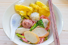 Noodles with meat ball and red sauce or yong tau foo,Thai Noodle Royalty Free Stock Images