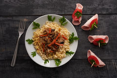 Noodles and meat boats. On the wooden table Stock Images