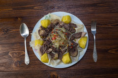 Noodles with meat on a plate Royalty Free Stock Photos