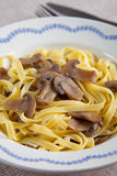 Noodles with mushrooms. Egg noodles with mushrooms and olive oil Royalty Free Stock Image
