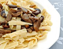 Noodles with mushrooms Stock Images