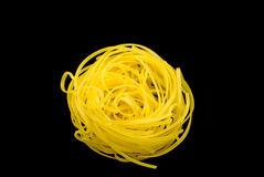 Noodles, noodle nest. Noodle nest on the black isolated background stock photo