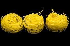 Noodles, noodle nest. Noodle nest isolated on black background stock photography