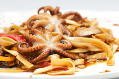 Noodles with octopuses, seafood and sauce Royalty Free Stock Photography