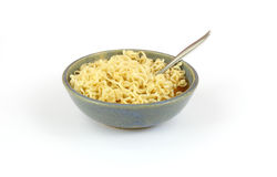Noodles in old stoneware bowl Royalty Free Stock Image