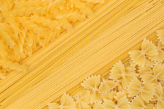 Noodles pasta spaghetti penne rigate background Stock Image