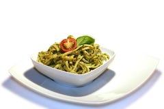 Noodles with pesto Stock Photos