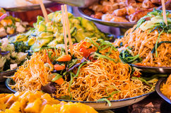 Noodles Plate at Food Street Market. Detail of a noodles plate at food street market in south east Asia Royalty Free Stock Photography