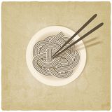 Noodles on plate old background Royalty Free Stock Photo
