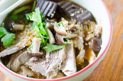 Noodles with pot-stewed duck in bowl Royalty Free Stock Photography