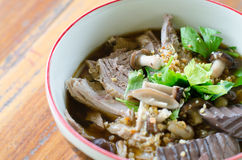 Noodles with pot-stewed duck in bowl Stock Photography