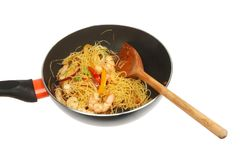 Noodles and prawns in a wok stock photography