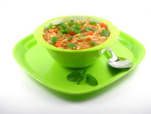 Noodles prepared with Tomato Gravy. Noodles, in a bowl, prepared with tomato gravy and chunks of carrot and tomato and dressing of coriander leaves.  The plate Royalty Free Stock Photo