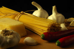 Noodles. Raw italien pasta with ingredients for spaghetti aglio e olio e peperoncino royalty free stock photo