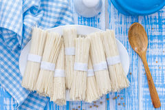 Noodles. Raw noodles on a plate Stock Photos