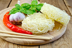 Noodles rice stranded with spices on the board Royalty Free Stock Image