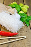 Noodles rice thin with spices and broccoli on the board Royalty Free Stock Photography