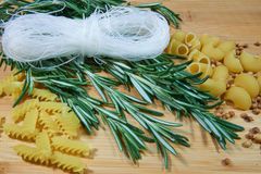 Noodles with rosemary. On wooden table stock photos