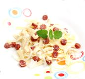 Noodles with salami Royalty Free Stock Image