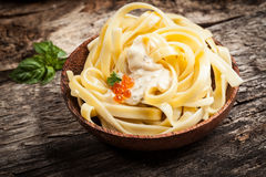 Noodles with sauce. And red caviar Stock Image
