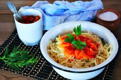 Noodles with sauce. Breakfast, noodles, lunch, food, food, sauce, carbohydrates, lunch, dinner, rustic stylein a plate of noodles with a tomato sauce, Chinese Stock Photography