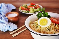 Noodles with sauce. Breakfast, noodles, lunch, food, food, sauce, carbohydrates, lunch, dinner, rustic stylein a plate of noodles with a tomato sauce, Chinese Royalty Free Stock Image